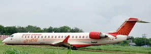 19 Jul 2011, Kanpur, India --- (110720) -- KANPUR, July 20, 2011 (Xinhua) -- An Air India plane is seen after it skidded off the runway at Kanpur airport in the state of Uttar Pradesh, India, July 20, 2011. The plane with 54 passengers on board Wednesday skidded on landing at Kanpur airport, but all passengers and crew members were safe. (Xinhua/Stringer) (wjd) --- Image by © Stringer/Xinhua Press/Corbis