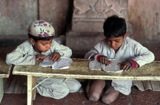 24 Dec 2004, Fatehpur Sikri, India --- Boys Reading in Koranic School --- Image by © Philippe Lissac/Godong/Corbis