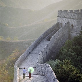 Hebei Province, China --- Boy and girl holding hands and walking on Jinshanling Great Wall --- Image by © Martin Puddy/Corbis
