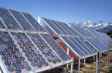 ca. 1985-1995 --- Solar energy panels in the Himalayas of northern India. --- Image by © David Cumming/Eye Ubiquitous/Corbis
