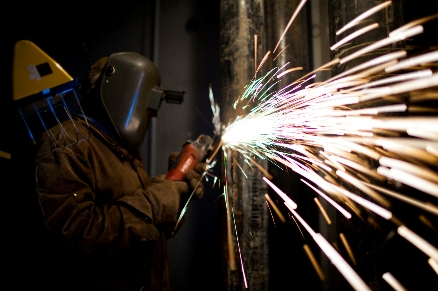 manual worker with metal cutting tool
