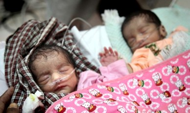 RAJASTHAN, INDIA September 19, 2010: Premature baby twins at the Facility Based Newborn Care Unit (FBNCU) at the Medical College of Udaipur. The Unit was first established with UNICEF support in Jaipur and the Udaipur facility has not been funded directly by UNICEF  but developed on a model piloted by UNICEF in Tonk district, Jaipur.It's purpose is to provide services to pregnant women, premature and sick babies and to educate women of the benefits of going to hospital to give birth. It has been responsible for a  dramatic rise in survival rates of newborns.   IKEA Chief Executive Officer Mikael Ohlsson and UNICEF India representative Karin Hulshof are part of a delegation visiting India to see first hand the IKEA Social Initiatives program that foster better living for the poor through self help groups,education and hygiene.  pic Graham Crouch/UNICEF