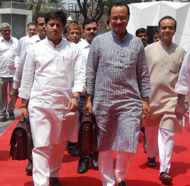 DY CM and Finance Minister Ajit Pawar and Minister of State for finance Rajendra Mulak is seen going to Vidhan Bhavan on Monday to present the Budget  ( pic by ? Gajanan Ghurye )