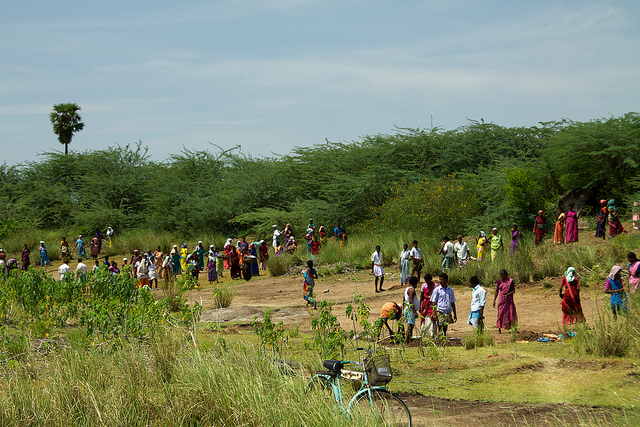 Rural villages digging out a silted-up water tank