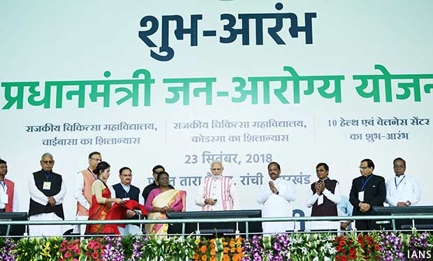 Ranchi: Prime Minister Narendra Modi launches 'Ayushman Bharat -Pradhan Mantri Jan Aarogya Yojana (AB-PMJAY)' along with Jharkhand Governor Droupadi Murmu, Chief Minister Raghubar Das and Union Health and Family Welfare J.P. Nadda on Sept 23, 2018. (Photo