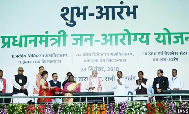 Ranchi: Prime Minister Narendra Modi launches 'Ayushman Bharat -Pradhan Mantri Jan Aarogya Yojana (AB-PMJAY)' along with Jharkhand Governor Droupadi Murmu, Chief Minister Raghubar Das and Union Health and Family Welfare J.P. Nadda on Sept 23, 2018. (Photo