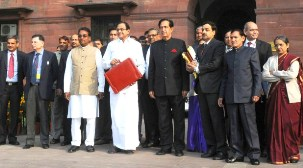 The Union Finance Minister, Shri P. Chidambaram departs from North Block to Parliament House to present the Interim Budget 2014-15, in New Delhi on February 17, 2014The Ministers of State for Finance, Shri Namo Narain Meena and Shri Jesudasu Seelam and other officials of the Ministry are also seen.