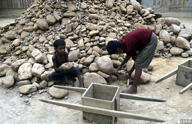 Children work at a stone crushing unit in Churaibari area of Tripura on April 30, 2014, a day ahead of International Workers' Day which is celebrated worldwide on 1st May to commemorate historic struggle of labour for their rights. (Photo: IANS)