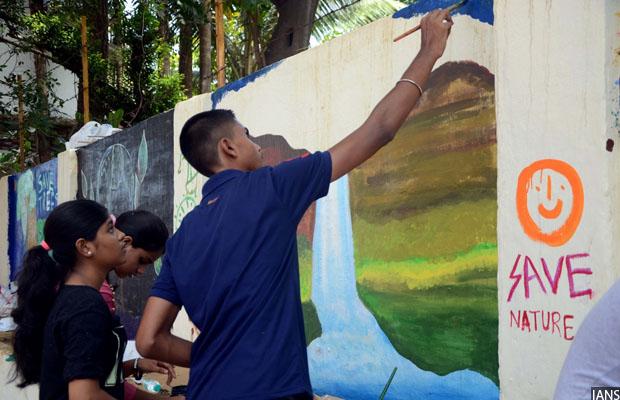 Mumbai: Children paint on walls on World Environment Day in Mumbai on June 5, 2017. (Photo: IANS)