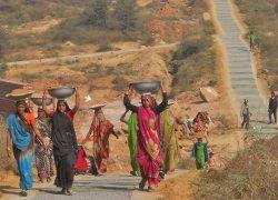 Women carrying dirt for trailside