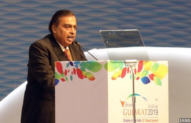 "Gandhinagar: Reliance Industries Chairman and Managing Director Mukesh Ambani addresses at ""Vibrant Gujarat Global Summit 2019"" in Gandhinagar on Jan 18, 2019. (Photo: IANS)"