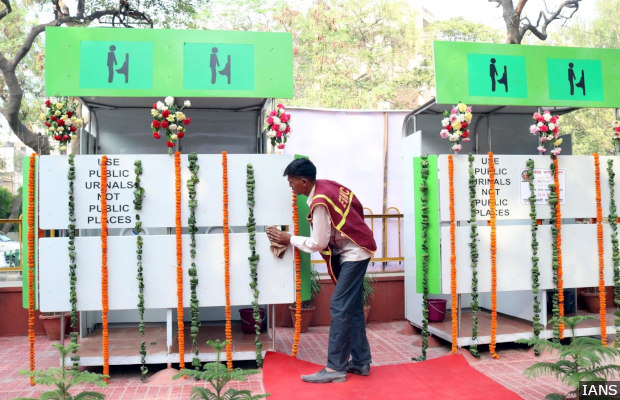 New Delhi: An East Delhi Municipal Corporation (EDMC)worker busy cleaning a NAMMA public toilet - sensor-based solar toilets, suggested by former president late APJ Abdul Kalam - ahead of its inauguration at  Sikka Market, shopping complex in New Delhi, on April 6, 2016. (Photo: IANS)