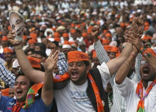 Supporters of Hindu nationalist Modi cheer as they listen to Modi during a rally in Hiranagar