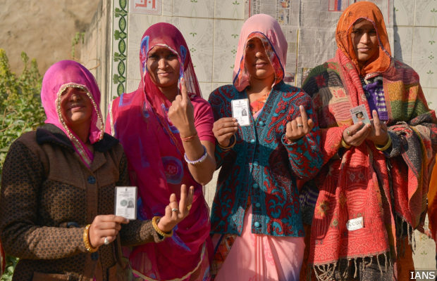 Ajmer: Women show their inked fingers after casting their votes for the Rajasthan Assembly elections, in Ajmer on Dec 7, 218. (Photo: Shaukat Ahmed/IANS)