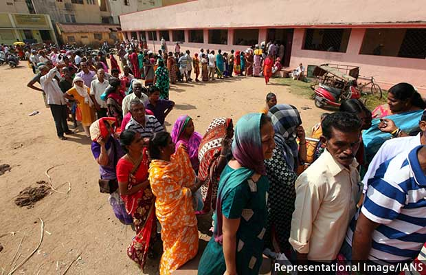 Chennai: People queue up outside a Chennai ration shop after the Tamil Nadu Government announced that it would provide a cash gift of Rs 1,000 and a gift hamper to all ration card holders in the state to celebrate Pongal festival, on Jan 11, 2019. However
