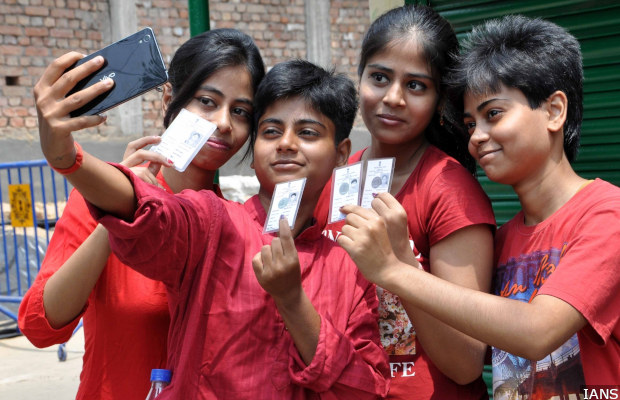 Kolkata: Young voters take a selfie after casting their votes at a polling booth during the fifth phase of West Bengal Legislative Assembly polls in Kolkata, on April 30, 2016. (Photo: Kuntal Chakrabarty/IANS)