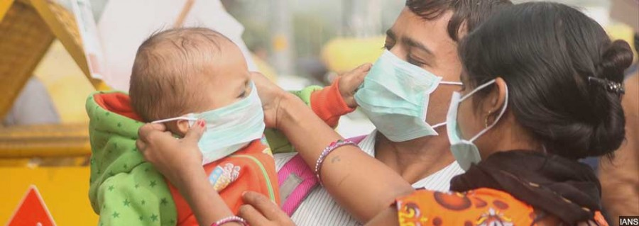 "New Delhi: People wear masks amid rising pollution levels in New Delhi on Nov 9, 2017. With no improvement in the air quality, Delhi-NCR continued to breathe toxins for the third consecutive day, as major pollutants across all monitoring stations in the region crossed ""severe"" level on Nov 9, 2017. (Photo: IANS)"