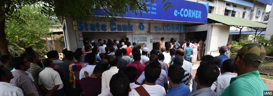 Nagaon: People wait outside an ATM, in Assam's Nagaon district on April 17, 2018. Currency shortage was reported in Andhra Pradesh, Telangana and Madhya Pradesh in the past few weeks. There were also complaints of shortage in parts of Maharashtra, Gujarat and Bihar. According to the Reserve Bank of India data, currency in circulation as on April 6 was Rs 18.17 lakh crore. (Photo: IANS)