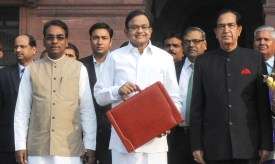 The Union Finance Minister, Shri P. Chidambaram departs from North Block to Parliament House along with Ministers of State for Finance, Shri Namo Narain Meena and Shri Jesudasu Seelam to present the Interim Budget 2014-15, in New Delhi on February 17, 2014