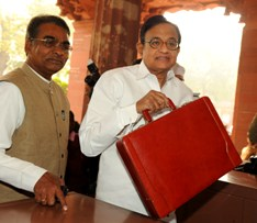 The Union Finance Minister, Shri P. Chidambaram arrives Parliament House to present the Interim Budget 2014-15, in New Delhi on February 17, 2014.The Minister of State for Finance, Shri Jesudasu Seelam is also seen.