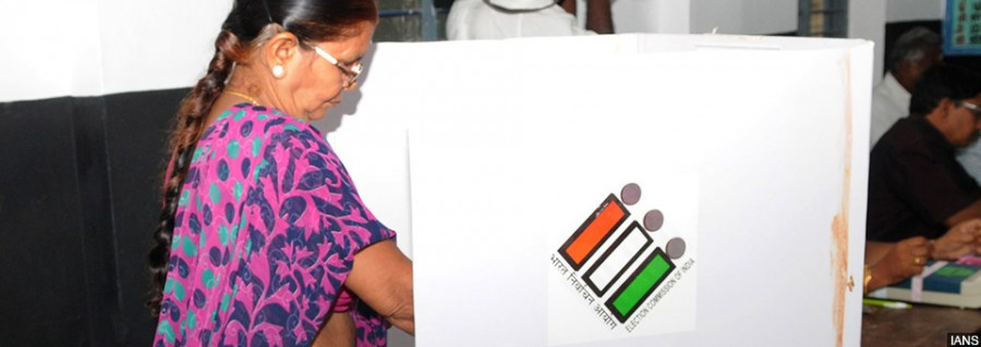 Puducherry: A female voter casting her vote, at a polling booth, during the Puducherry Assembly Election, on May 16, 2016. (Photo: IANS/PIB)