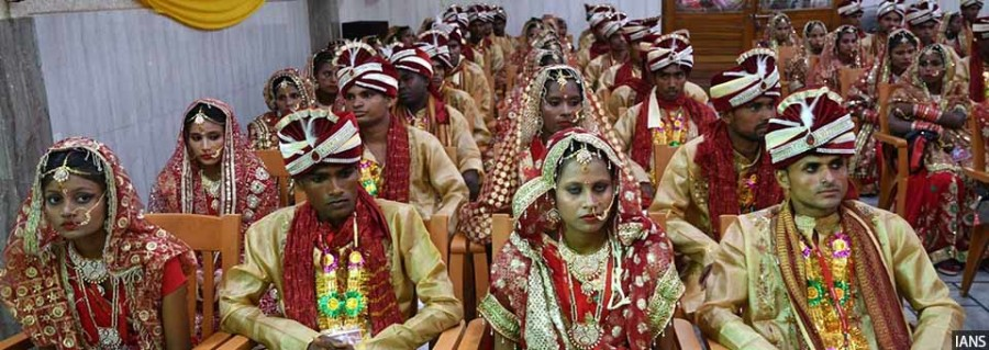 Patna: Brides and grooms during a mass marriage ceremony, in Patna on July 15, 2018. (Photo: IANS)