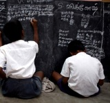 Students work at a blackboard set up at ground level in a class at the UNICEF-assisted government primary school in Periyakuppam Village in Cuddalore District in Tamil Nadu State. The school is applying an activity-based learning model for grades 1 through 4, whereby children learn at their own pace in a child-friendly environment. Almost all of the students in the class are from poor fishing families that were affected by the tsunami. The learning model is being implemented in the states 40,000 primary schools. [#2 IN SEQUENCE OF FIVE]  By November/December 2008 in India, post-tsunami recovery and reconstruction efforts had shifted to long-term development, almost four years after the 26 December 2004 earthquake off the western coast of Indonesia and subsequent tsunamis devastated coastal areas in more than eight countries. More than 12,000 Indians were killed and an estimated 600,000 were displaced in the disaster. The southern state of Tamil Nadu was among the worst-affected areas: Over 8,000 people died; and some 480 children lost both parents to the tsunami. Working with government authorities, local communities, UN, NGO and other partners, UNICEF has supported efforts to increase access to health care and education, and to restore and improve community-based health services, water supply systems and schools  to build back better. UNICEF is also supporting psychosocial recovery programmes.