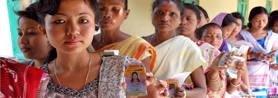 Women arrive to cast their votes at Ghagra Kachari L P School polling booth in Tezpur parliamentary constituency of Assam during the first phase of 2014 Lok Sbaha Polls on April 7, 2014. Elections are being held in five constituencies of Assam and in one constituency of Tripura. (Photo: IANS)